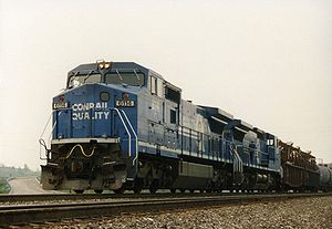 Conrail 6114, a GE Dash 8-40CW, leads a train westbound out of Altoona, Pennsylvania.