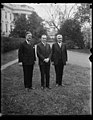 Calvin Coolidge, center; outside White House, Washington, D.C. LCCN2016888020.jpg