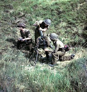 History of the Canadian Army - Canadian mortar team in action in France, c. 1944.