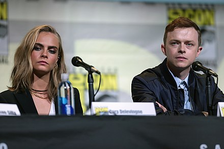 DeHaan with Cara Delevingne at the 2016 San Diego Comic Con. Cara Delevingne & Dane DeHaan (28439120622).jpg