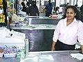Cashier at her register.jpg