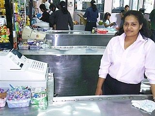 Cashier person who handles the exchanging of money for goods at a store