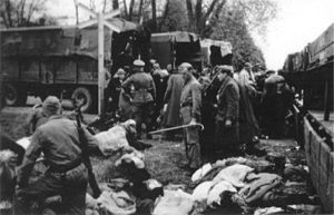 Chełmno extermination camp - Chelmno extermination camp did not have direct rail connections. Jews were delivered by train to Koło, then to nearby Powiercie, and in overcrowded lorries to camp. They were forced to abandon their bundles along the way. At the manor house in Chełmno, they were compelled to undress for transport to a bath, unaware that it was the final stage of their lives. In this photo, loading of victims sent from the ghetto in Łódź