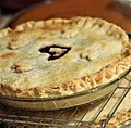 Cherry pie with heart in center, on rack with other pies (30885761190).jpg