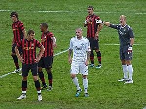 Aleksandar Kolarov - Kolarov (furthest back) defending against the Vancouver Whitecaps FC in July 2011