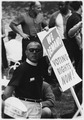 "Civil Rights March on Washington, D.C. (A man holding a sign that reads ""We Demand Voting Rights Now"") - NARA - 542036.tif"