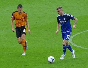 Joe Ralls - Ralls (in blue) attacking against Wolverhampton Wanderers.
