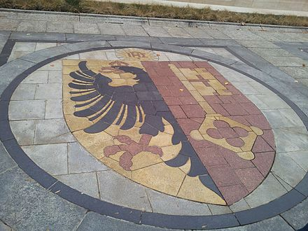 Coat of arms of Geneva as part of the pavement in front of the Reformation Wall, 2013 Coat of arms of Geneva.jpg