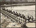 Colonel Sam Hughes and staff crossing pontoon bridge (19526768062).jpg