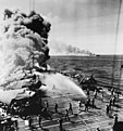 Crewmen fighting fires aboard USS Belleau Wood (CVL-24), 30 October 1944 (80-G-342020).jpg