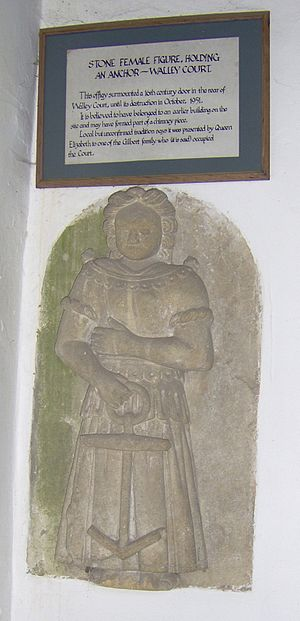 St Andrew's Church, Chew Stoke - Female stone sculpture holding an anchor, in the porch