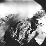 Cushing Glacier, icefield extending into a valley glacier, August 22, 1979 (GLACIERS 5363).jpg