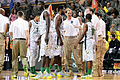 Dana Altman and Oregon players - ESPN Armed Forces Classic - Game Day - U.S. Army Garrison Humphreys, South Korea - 9 Nov. 2013.jpg