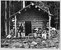 David Denny at log cabin near Lake Keechelus, 1899 (MOHAI 7236).jpg