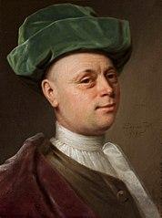 Portrait of a man in green hat.