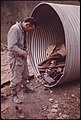 Doren Bishop, Superintendent for Robin Mines Owned by the Alma Coal Corporation near Clothier and Madison, West Virginia Puts on Mining Coveralls Next to a Metal Culvert...04-1974 (3907215770).jpg