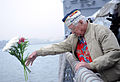 Duane Reyelts, a Pearl Harbor survivor, tosses flowers off the side of the guided missile frigate USS De Wert (FFG 45) during a ceremony commemorating the 71st anniversary of the attack on Pearl Harbor 121207-N-TC587-044.jpg