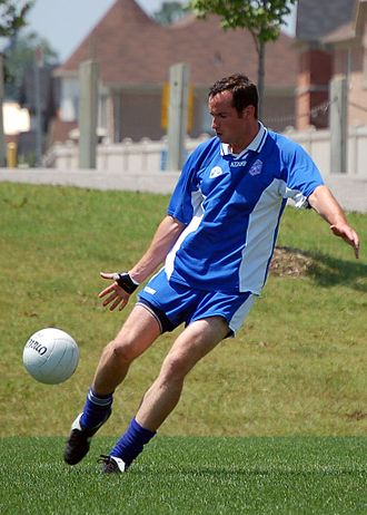 Gaelic football - A player from a Canada GAA club shoots for goal