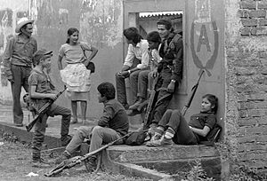 Feminism in Latin America - Men and Women both participated in revolutions that presented Revolutionary Feminism. These soldiers are fighting in the civil war in El Salvador.