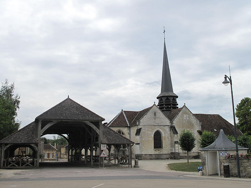 The church and the market hall of Lesmont (Aube, France).