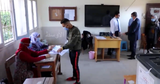 A young Egyptian voter inside a polling station