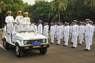 Two-star rank - An Indian Navy Rear Admiral in a car having two-stars.