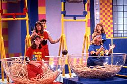 435beece9d756 A 1990 Family Double Dare toss-up physical challenge showing two  contestants trying to catch a