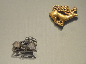 Animal style - The influence of Scythian art: Fibula in the Form of a Recumbent Stag (below), about 400 AD, Northeastern Europe, and Stag Plaque (above), 400-500 BC, Scythian, western Asia, gold