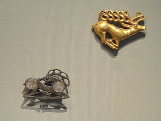 Scythian art - The influence of Scythian art: Fibula in the Form of a Recumbent Stag (below), about 400 AD, Northeastern Europe, and Stag Plaque (above), 400-500 BC, Scythian, western Asia, gold
