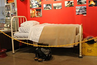 Firefighting in the United States - A firefighter's bunk with uniform ready to wear in the San Antonio Fire Museum in San Antonio, Texas