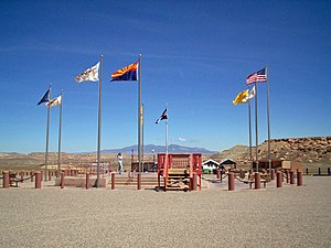 Four Corners Monument - Flags surrounding the Four Corners Monument. In clockwise order starting from the frontmost flag, the state flag of Arizona, Flag of the Navajo Nation (twice), Utah, Ute Mountain Ute Tribe Reservation, Colorado, New Mexico, Navajo Nation (third instance), and the flag of the United States.