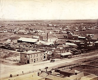 Charles Farr (builder) - Portion Victoria Square and Franklin Street taken from the GPO tower in 1865. Farr's woodyard in middle foreground.