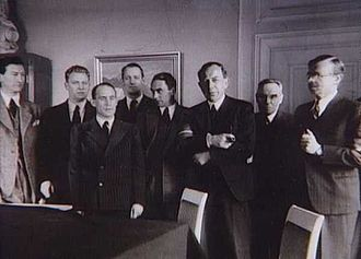 Danish Freedom Council - Members of the Danish Freedom Council after the Occupation. From left: Erik Husfeldt, Alfred Jensen, Frode Jakobsen, Børge Houmann, Mogens Fog, Aage Schoch, Ole Chievitz and C.A. Bodelsen. Arne Sørensen are standing outside of the edge. Absent: Erling Foss, Niels Banke and Hans Øllgaard.
