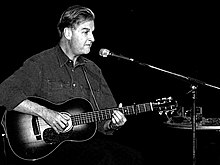 Geoff Muldaur performing with his guitar