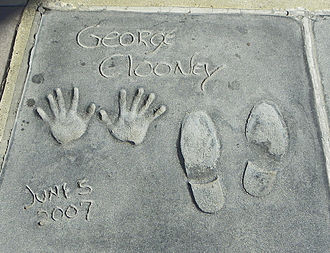 George Clooney - George Clooney cast his hands and shoes in the Grauman's Chinese Theatre in 2007.