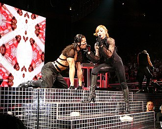 "Get Together (Madonna song) - Madonna singing ""Get Together"" on the Confessions Tour while caressing her dancer, who poses like a horse on the stage."