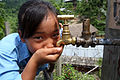 Girl drinks from a tap at a NEWAH WASH water project in Puware Shikhar, Udayapur District, Nepal. (10697893275).jpg