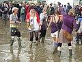 Glastonbury Festival attendees standing in the mud (2007).jpg