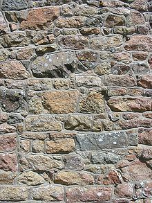 Granite wall of chapel La Hougue Bie, Jersey.jpg