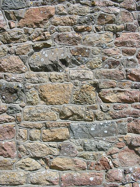 File:Granite wall of chapel La Hougue Bie, Jersey.jpg