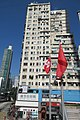 HK 鰂魚涌 Quarry Bay King's Road 英皇大樓 King's House facade Tong Chong Street red flagpoles Jan 2017 IX1 CASA 880.jpg