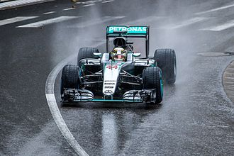 Rain tyre - Lewis Hamilton competes through the rain at the 2016 Monaco Grand Prix.  The treads of his wet tyres are visible.