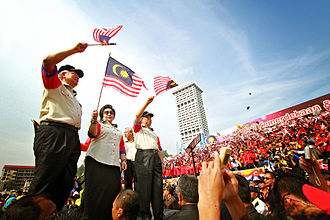 Najib Razak - Najib and his wife Rosmah waving flags during the Malaysia Day celebration in Kuala Lumpur, 16 September 2011