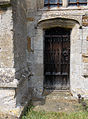 Harlaxton Ss Mary and Peter - exterior South Chapel door.jpg