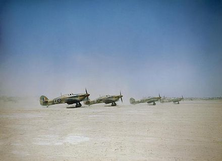 Hawker Hurricanes Mark IID on a Tunisian airfield, preparing for a ground attack mission, April 1943. Hawker Hurricane Mark IID 'tank busters' of No. 6 Squadron about to take off from Gabes in Tunisia, 6 April 1943. TR869.jpg