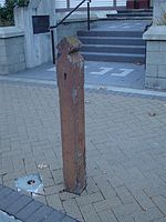 View of an old wooden post