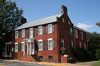 I-house - The Dr. Holladay House in Orange, Virginia. The original brick house (ca. 1830) was a Federal-style I-House.