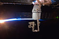 ISS-31 SpaceX Dragon commercial cargo craft is berthed to the Harmony node with rays of sunshine and the thin blue atmosphere of Earth.jpg