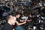 ISS-61 crewmembers gather inside the Destiny lab.jpg