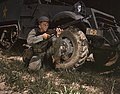 Infantryman with halftrack, a young soldier of the armed forces, holds and sights his Garand rifle like an old timer, Fort Knox, Ky.jpg